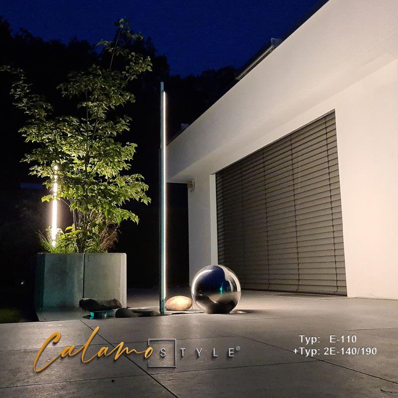 Design-Aussenleuchte für Terrassenbeleuchtung um Brunnen gruppiert